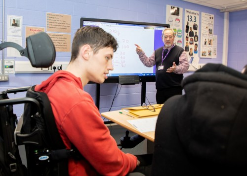 A student in a wheelchair in a maths lesson