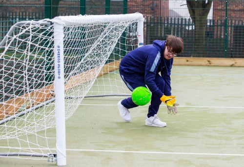 A student in front of a goal whilst playing a ball game