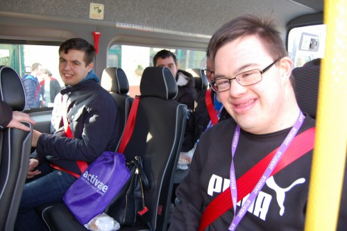 Students aboard the minibus smiling