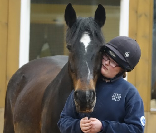 Student thanking a horse after a session