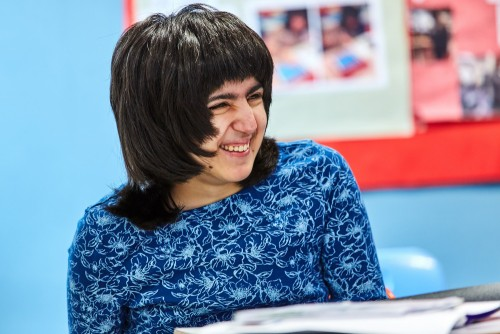Learner smiling during a lesson