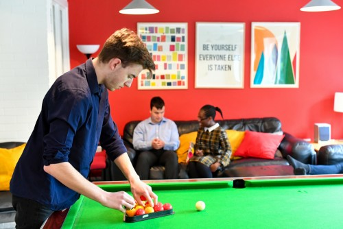 Male student playing pool