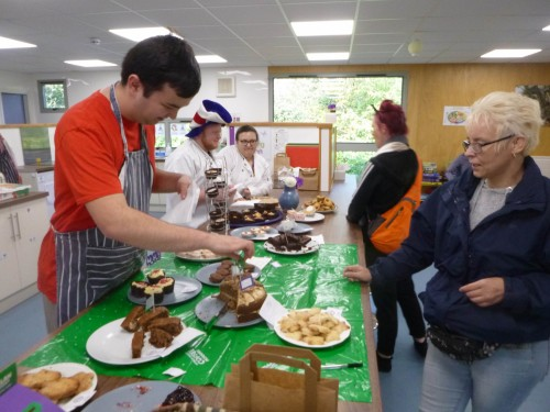 Students using in our vocational hub to make and serve cakes for charity