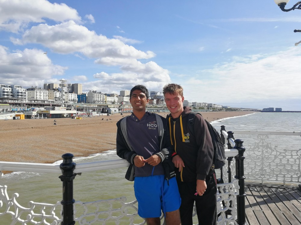 Students enjoying Brighton seafront.