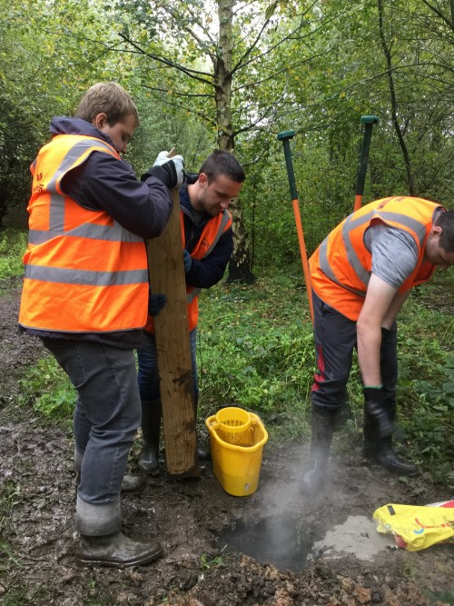 Students working together at one of their work placements maintaining a local country park.