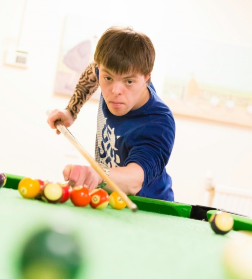 learner playing pool