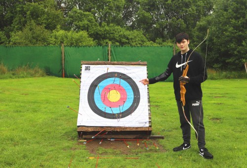 Learner practising archery skills on an activity day.